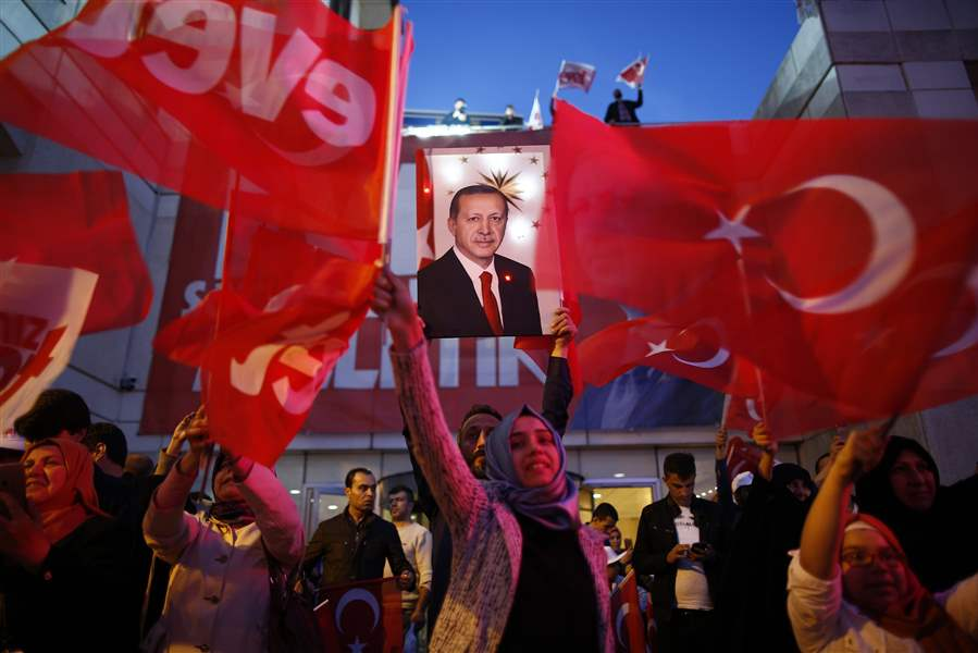 Erdogan claims victory in vote over sweeping new powers