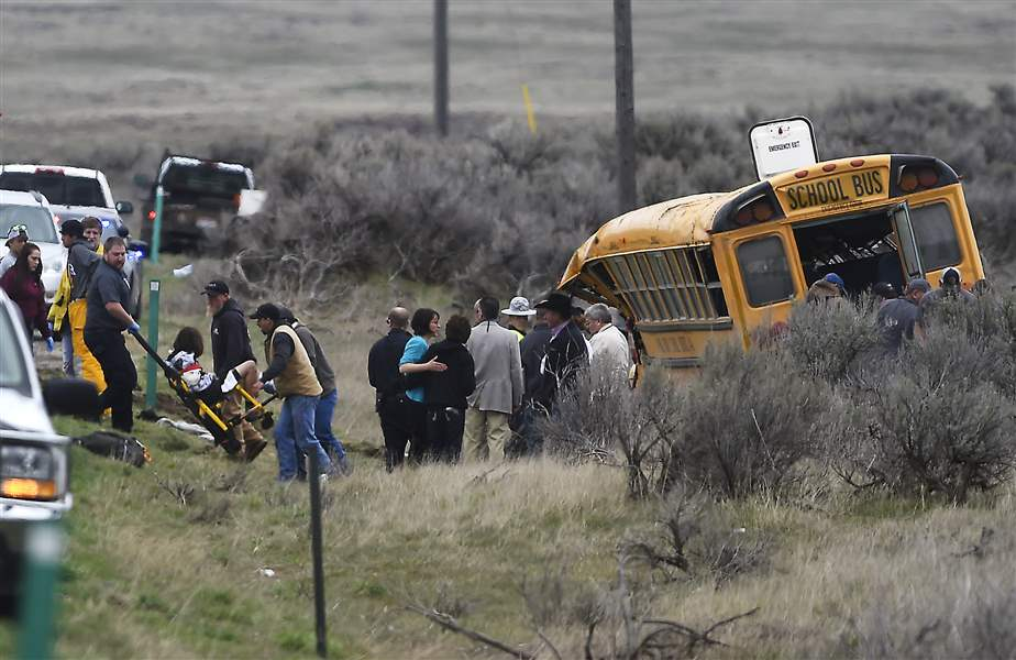 Idaho school bus rolls over, 17 taken to hospitals