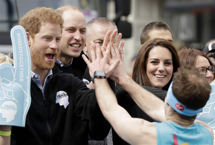 Prince William, Kate startled after water squirted at them by runner