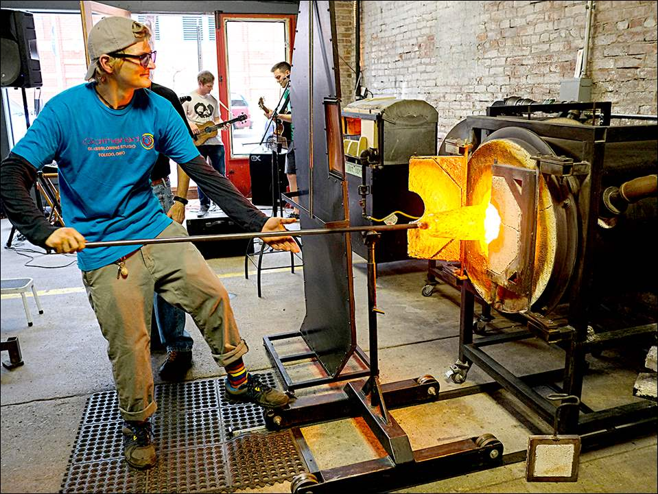Glass artist Jon Zapiecki gives a demonstration at Gathered Glassblowing Studio during the Art Loop.