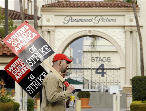 Hollywood writers overwhelmingly approve strike