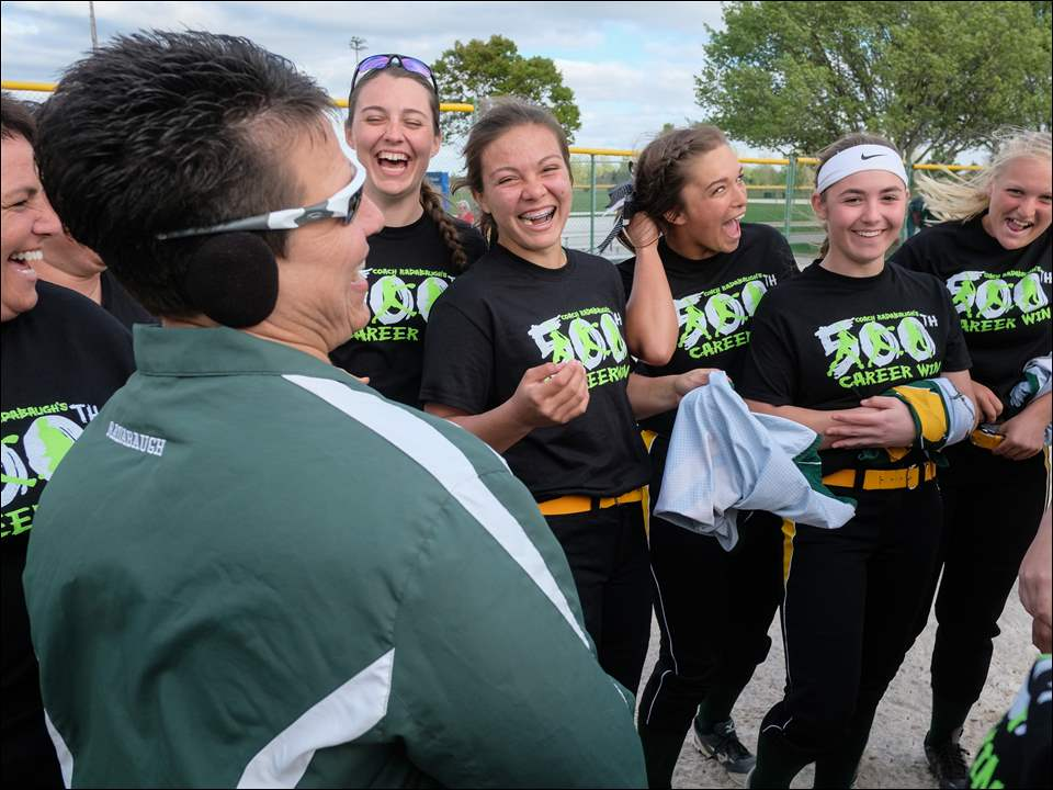 Oregon Clay softball coach Brenda Radabaugh celebrates her 500th career victory with her players after the Eagles defeated Central Catholic 9-1.