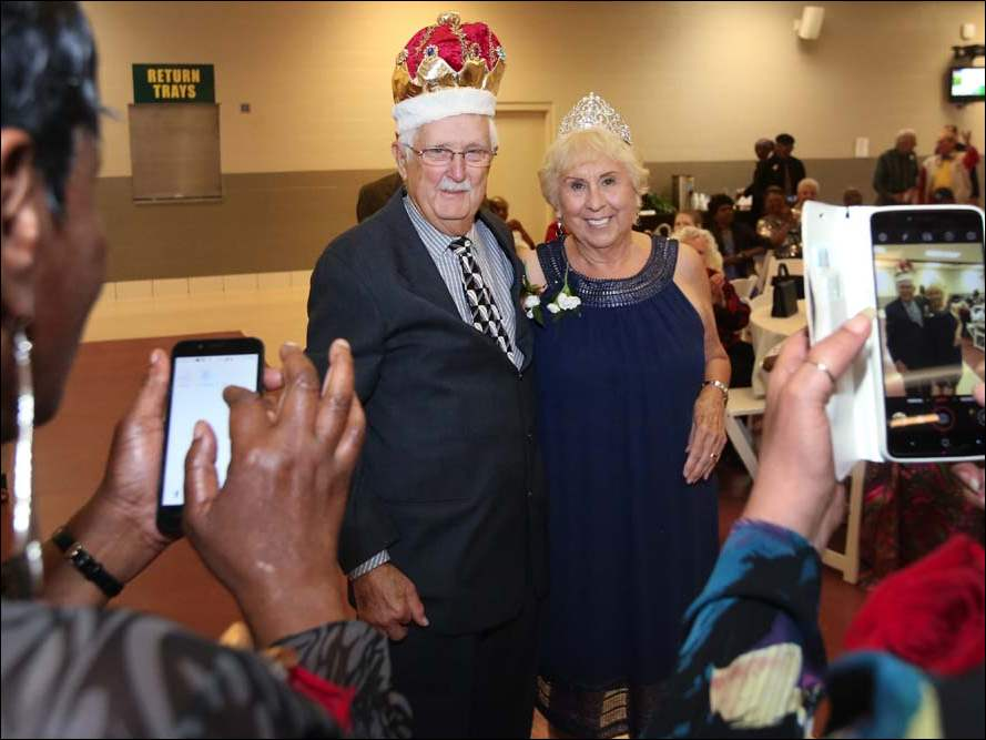 John Puls, 86, center left, and Mira Samson, 86, center right, were crowned Prom King and Queen at the Fourth Annual Senior Prom.