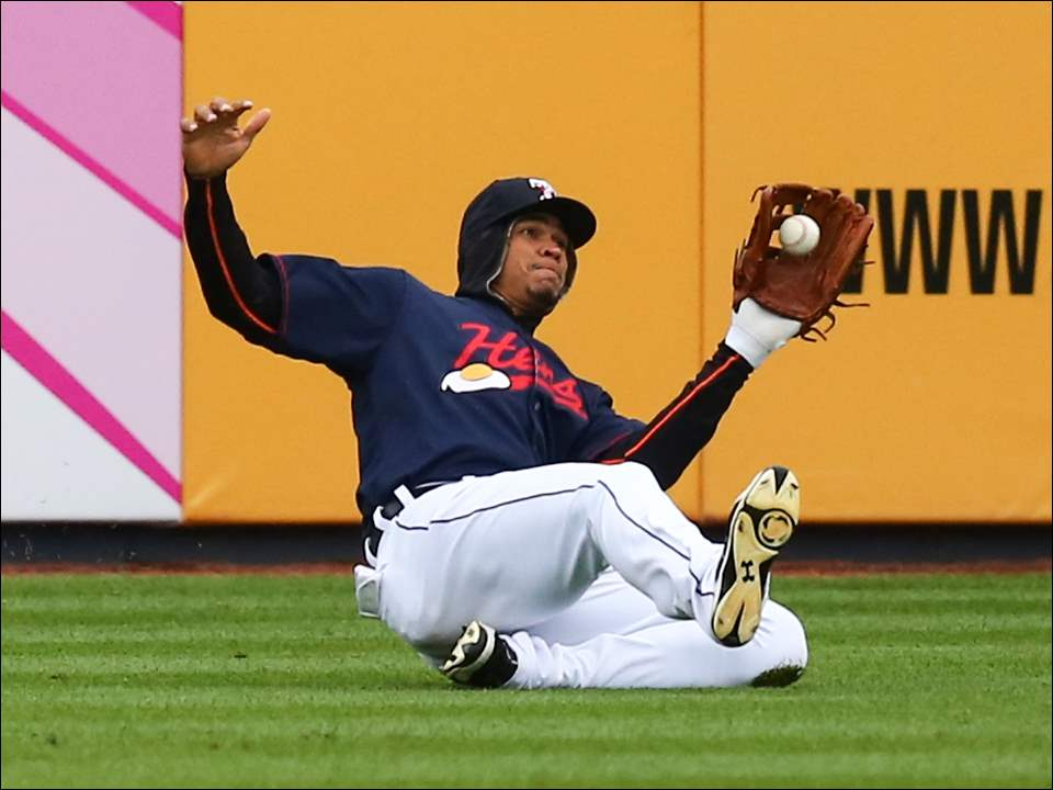 Toledo right fielder Steven Moya makes sliding catch during the first game of the doubleheader. Lehigh Valley defeated the Mud Hens 6-1.