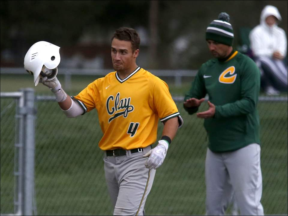 Clay's Christian Orr acknowledges earning the most hits in Clay baseball history after hitting a double against Central Catholic Monday at Mercy Field.