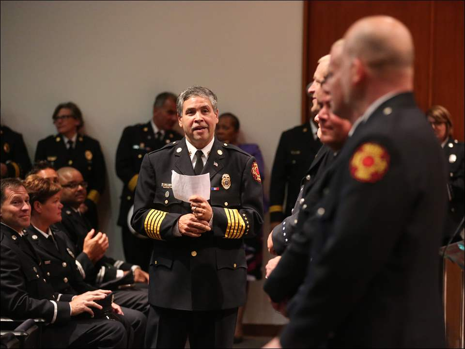 Toledo Fire Department Chief Luis Santiago introduces five of the 10 lieutenants who were promoted during the ceremony.