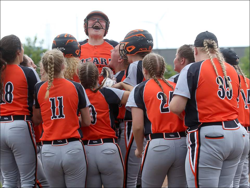 Gibsonburg's Abby Cantrell, center, is cheered by her team after hitting a home run.