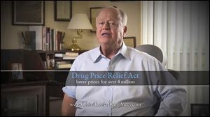 A television advertisement favoring a drug-pricing issue on Ohio's November ballot featured Max Cleland, a Georgia veteran who lost both legs and an arm in a grenade blast in Vietnam.