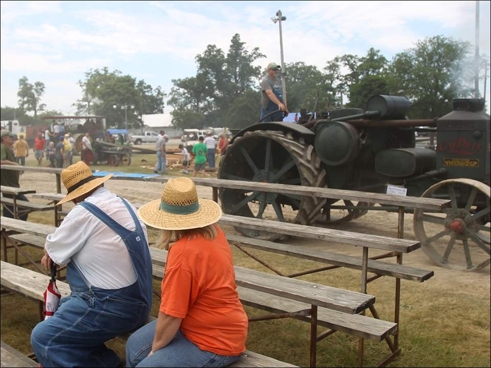 Spectators watch steam tractors going around during the 73rd Annual Reunion of the National Threshers Association at the Fulton County Fairgrounds in Wauseon, Ohio, June 22.