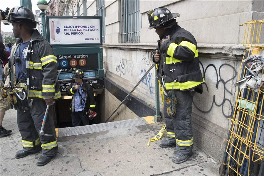 Subway train derails, scaring passengers and injuring dozens