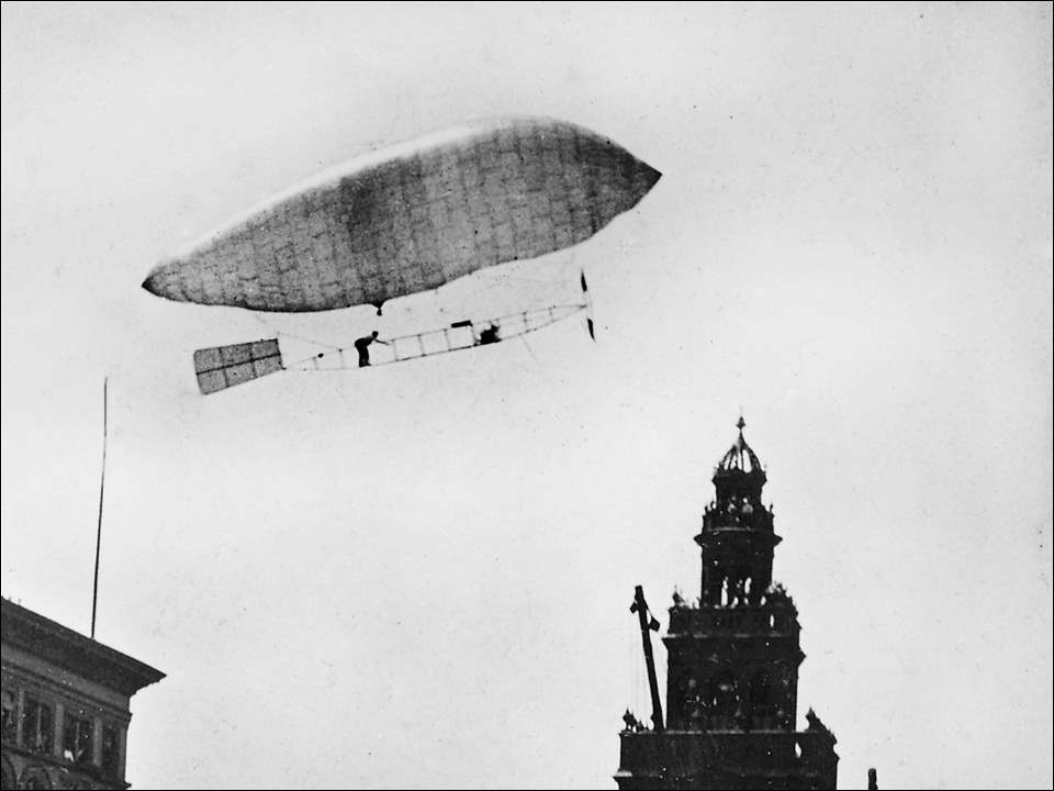 "When Toledoans looked skyward on June 30, 1905, they spotted something never seen here before: a 58-foot-long dirigible made of Japanese silk that floated from the fairgrounds at Dorr Street and Upton Avenue to downtown. Augustus Roy Knabenshue maneuvered the airship 1,000 feet above the ground, steering it to the top of the Spitzer Building.  He landed it safely, amid smokestacks and wires, as spectators gazed at the contraption. It was the first powered flight in Ohio and was captured in this archived photo from the Toledo Blade. In the photo the Nasby Building is on the right, and on the left is the Spitzer Building.  The son of Samuel Knabenshue, a former editor of the Weekly Blade, Roy came from a well-respected Toledo family that was a little puzzled by his aerial pursuits. His father became the U.S. consul in Belfast and his brother, Frederick, was a Spanish-American War hero.  Roy Knabenshue, a 29-year-old electrical engineer, named his invention the ""Toledo No. 1."" In August of 1905, Knabenshue made the first airship flight over New York City, landing ""Toledo No. 2"" on a tree in Central Park.  In 1910, the former dirigible driver became the manager for the Wright Co.'s (as in the Wright Brothers) exhibition team as the fascination with dirigibles shifted to airplanes."