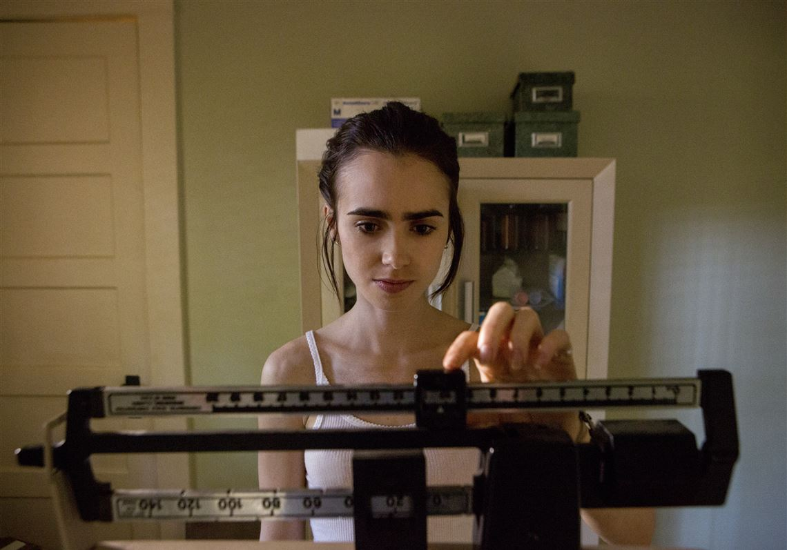 This image released by Netflix shows Lily Collins in