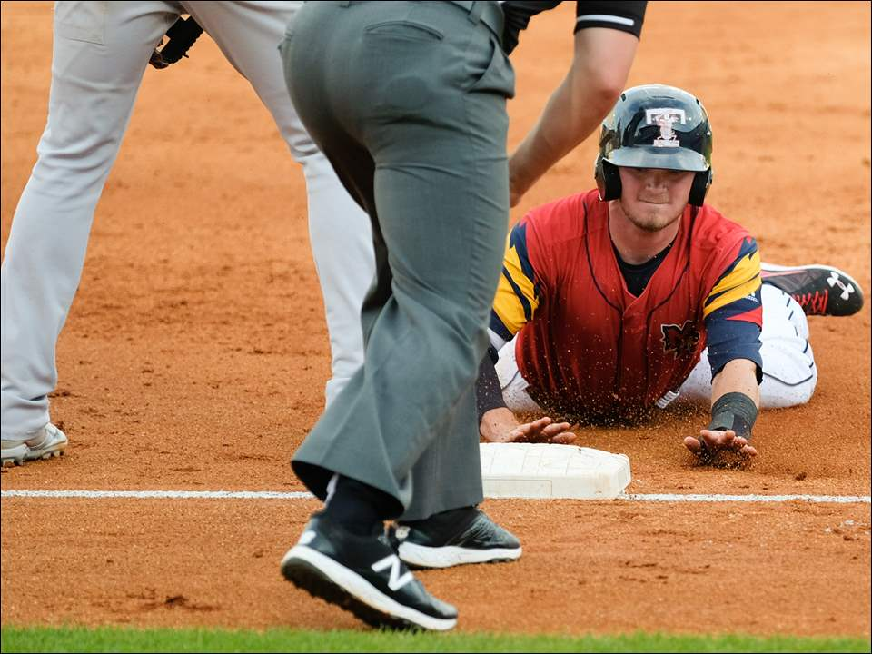 Kody Eaves of the Mud Hens steals third base Sunday against Rochester.
