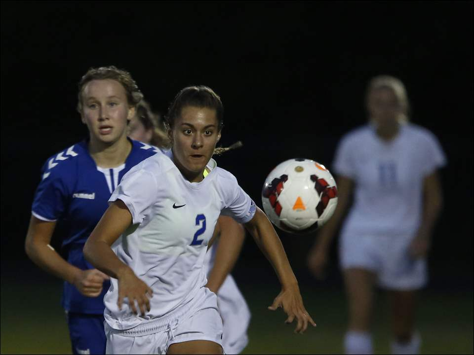 Anthony Wayne's Emilie Reese keeps in front of St. Ursula's Lily Turski during soccer game at Anthony Wayne High School in Whitehouse on Monday.