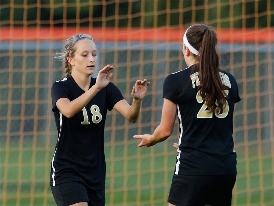 Perrysburg's Addie Graham (18) celebrates scoring a goal with Kristina Demarco against Sylvania Southview. Graham finished with 4 goals and Yellow Jackets beat Southview, 6-1.