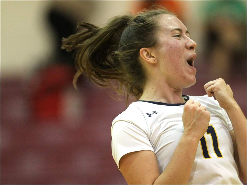 Notre Dame Academy's Jillian Shook celebrates after a point during Thursday's Three Rivers Athletic Conference match against Central Catholic. Notre Dame won, 3-0.
