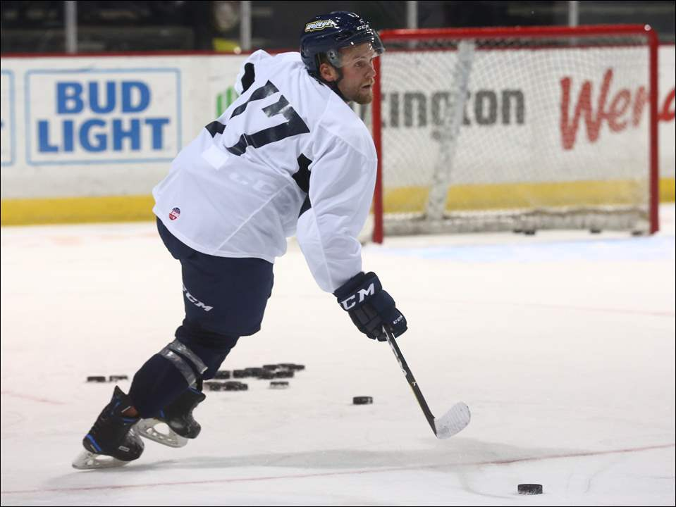 Beau Schmitz takes control of the puck during the first practice of training camp for the Toledo Walleye at the Huntington Center.