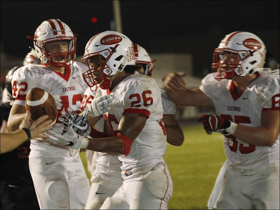Eastwood's Jaden Rayford (26) celebrates his touchdown with teammates during Friday's 39-0 win over Otsego.