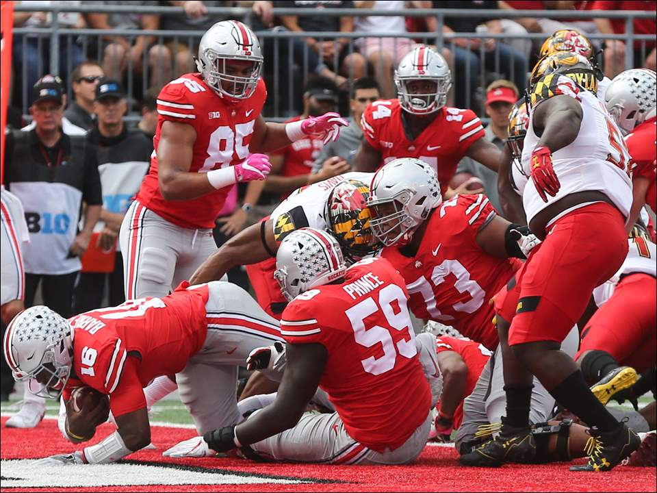 Ohio State quarterback J.T. Barrett dives into the end zone for a touchdown during Saturday's win over Maryland in Columbus.