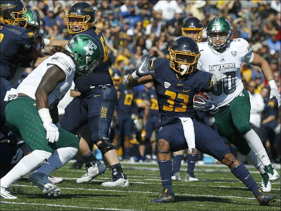 Toledo's Art Thompkins runs the ball against Eastern Michigan.