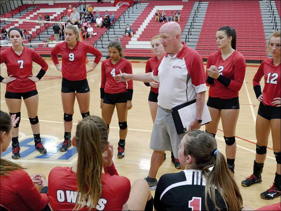 Owens' assistant coach Denny Caldwell gives instruction during a timeout during a volleyball game against Lorain County Community College at Owens Community College in Perrysburg Township on Oct. 4.