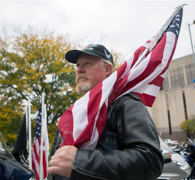 Air Force veteran Gary Jennings of Temperance Mich. holds an American flag as he waits for John Mellenc& to speak to kick off the Walk to End Veteran ... & Toledou0027s Tent City to help homeless veterans - The Blade