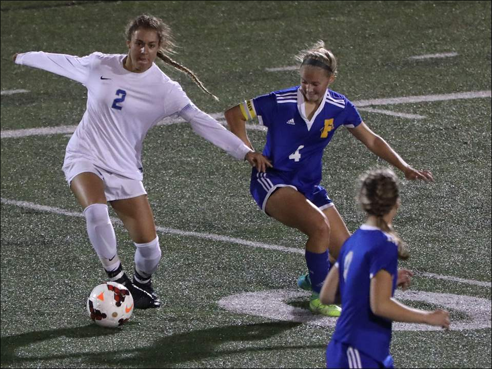 Anthony Wayne's Emilie Reese keeps the ball from Findlay's Jaclyn Bendt during the District 1 semifinal soccer game at Springfield High School in Holland, Ohio.