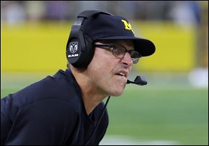 Michigan head coach Jim Harbaugh could only watch as the Wolverines saw some major targets get away on signing day.