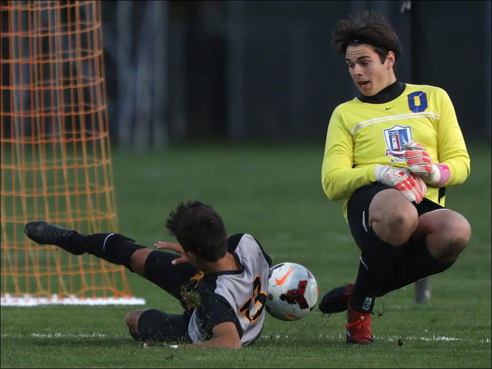 Northview's Ruben Gonzalez attempts to score as St. Francis goalie Matt Dills defends during Wednesday's Division I district semifinal soccer match at Southview High School.