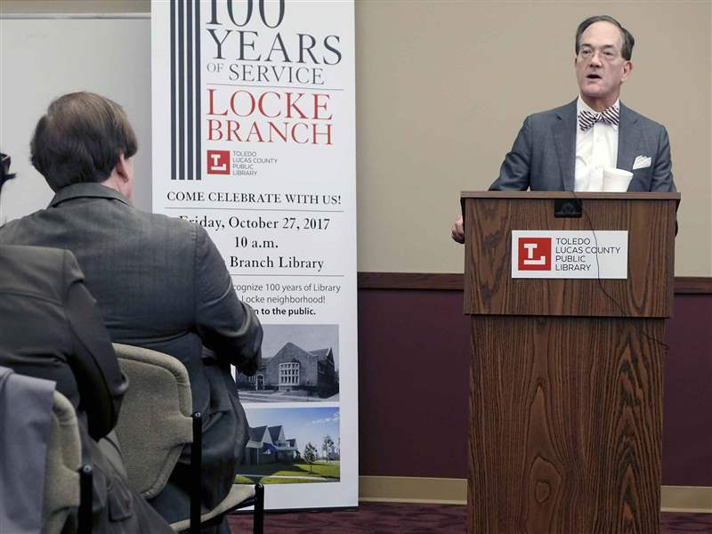 The Blade publisher and editor-in-chief John Robinson Block speaks during a ceremony at the Locke Branch Library in Toledo to recognize 100 years of librar