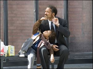 This undated publicity photo released by Columbia Pictures, shows actors Jaden Christopher Syre Smith, left, and Will Smith in a scene from the film