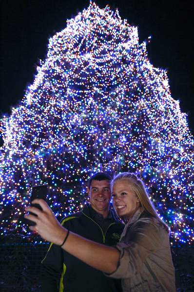 aaron siebeneck and toni steffan ottawa take a photo as the big tree is lit during the lights before christmas presented by keybank at the toledo zoo on - Toledo Zoo Lights Before Christmas
