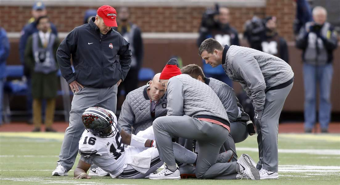 Ohio State QB JT Barrett leaves MI game with leg injury