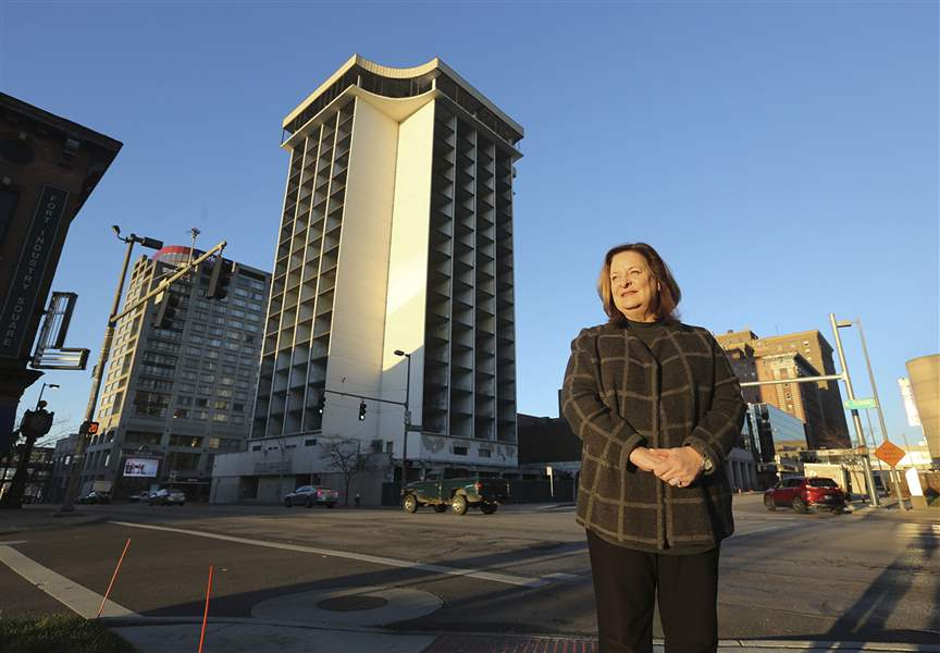 With The Former Seagate Hotel Behind Her Lucas County Commissioner Carol Contrada Is Pictured On Summit Street Friday December 1 2017 In Downtown Toledo