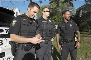 Sgt. Kevan Toney, left, Tweets after a foot pursuit on Boydson near Monroe Street with Officers Ei McCord, middle, and Jeron Ellis, all of the Toledo Police Department.