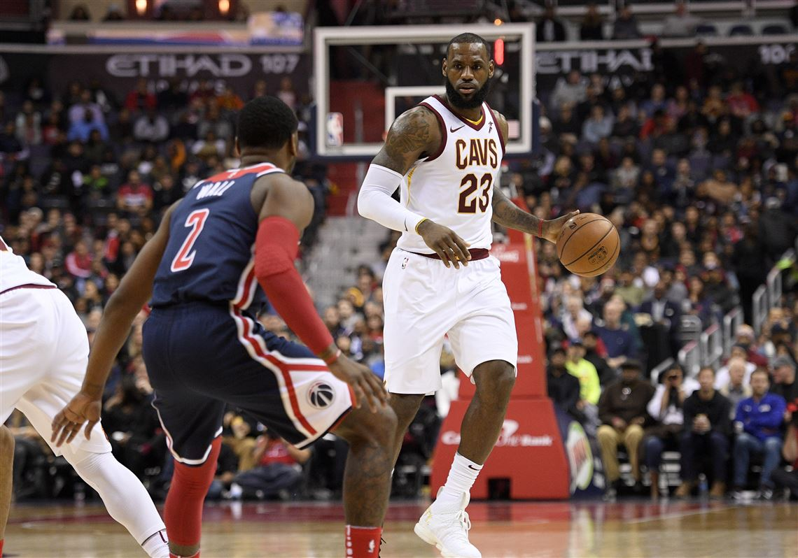 937971923273 Cleveland Cavaliers forward LeBron James dribbles against Washington  Wizards guard John Wall on Sunday in Washington