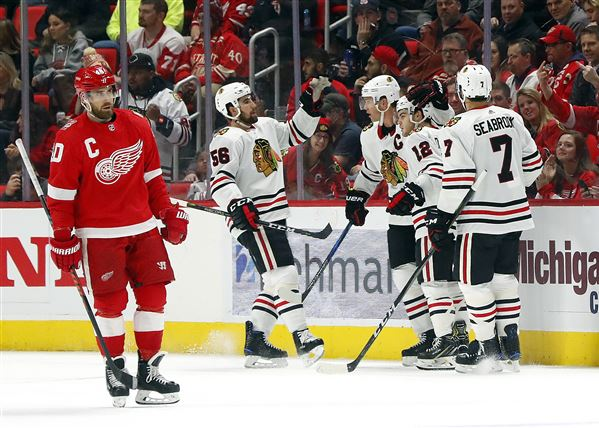 DeBrincat scores hometown hat trick as Blackhawks beat Red Wings