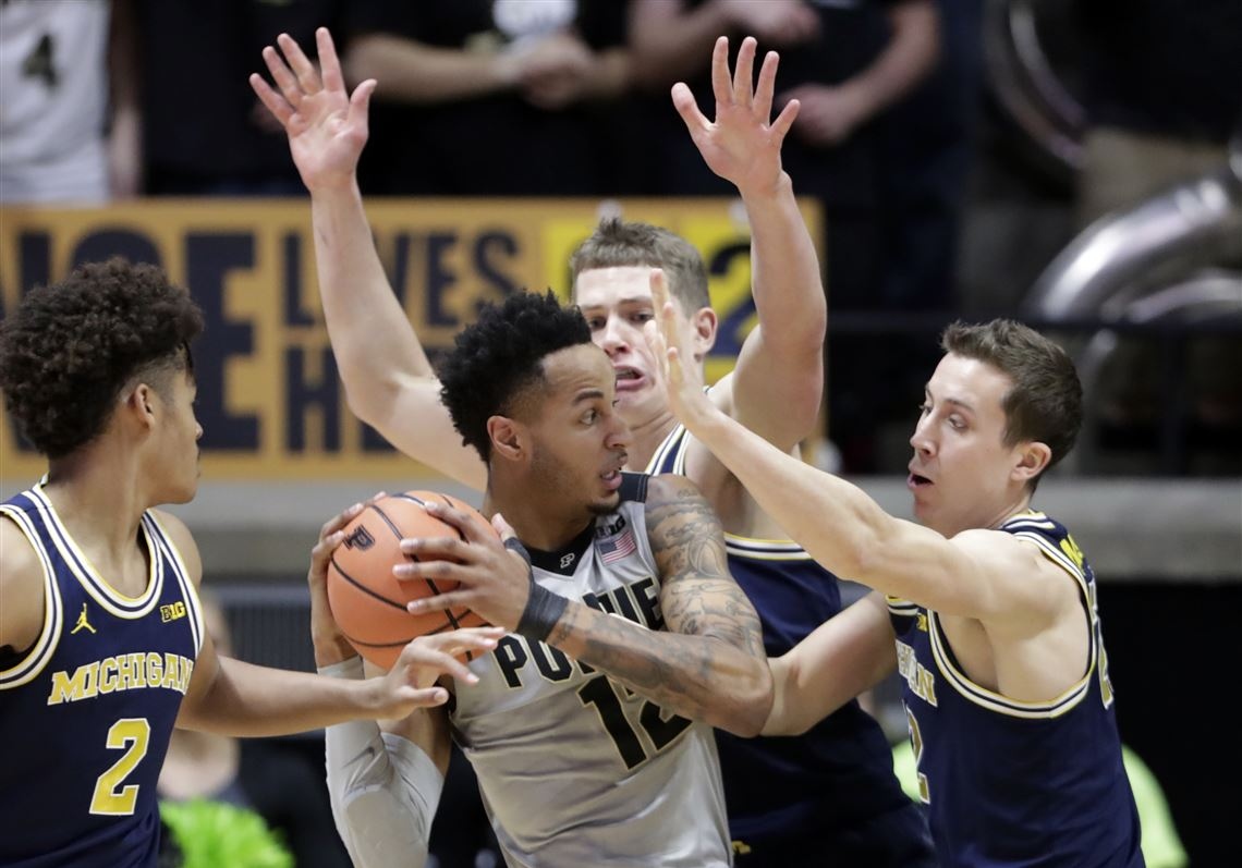 db44c083c62 Purdue forward Vincent Edwards is stopped by Michigan's Duncan Robinson,  right, and Moritz Wagner