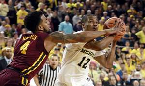 APTOPIX-Minnesota-Michigan-Basketball
