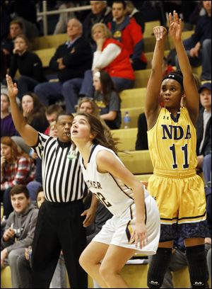 Notre Dame's Kailah Johnson, right, shown in a game earlier this season, scored 21 points for the Eagles Thursday in a 68-29 win over Fremont Ross.