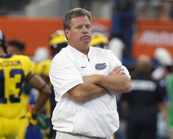 Former UF coach McElwain hired to be assistant at MI