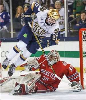Notre Dame's Bobby Nardella flips as he hits Ohio State's Sean Romeo (30) during a game earlier this year. The Fighting Irish and Buckeyes finished the regular season in first and second, respectively, in the Big Ten.