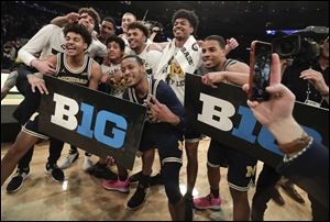 Michigan players celebrate after beating Purdue 75-66 to win the NCAA Big Ten Conference tournament championship college basketball game, Sunday, March 4, 2018, in New York.