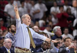 Michigan head coach John Beilein gestures during a game against Maryland.
