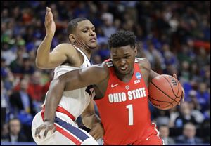 Ohio State forward Jae'Sean Tate, right, tries to drive around Gonzaga guard Zach Norvell Jr. during their second round NCAA Tournament game in Boise, Idaho.