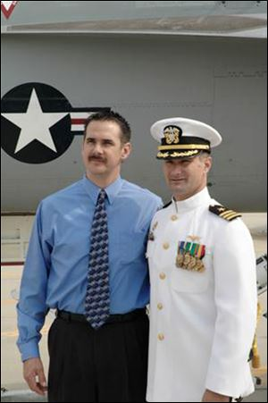 Left Chad Albert, of Toledo, with his cousin, Cmdr. David Fravor, in an October, 2004, file photo when Commander Fravor took command of VFA-41, Strike Fighter Squadron 41 also known as the