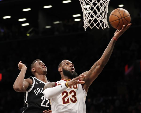 LeBron James dunks on two Nets players as if they weren't there