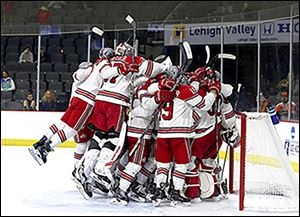 Ohio State celebrates its 5-1 win against Denver. The Buckeyes are one of three Big Ten teams in this year's Frozen Four.