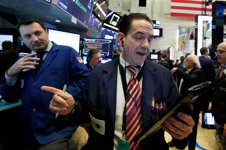 Wall Street rises but pares gains late after report of Federal Bureau of Investigation raid