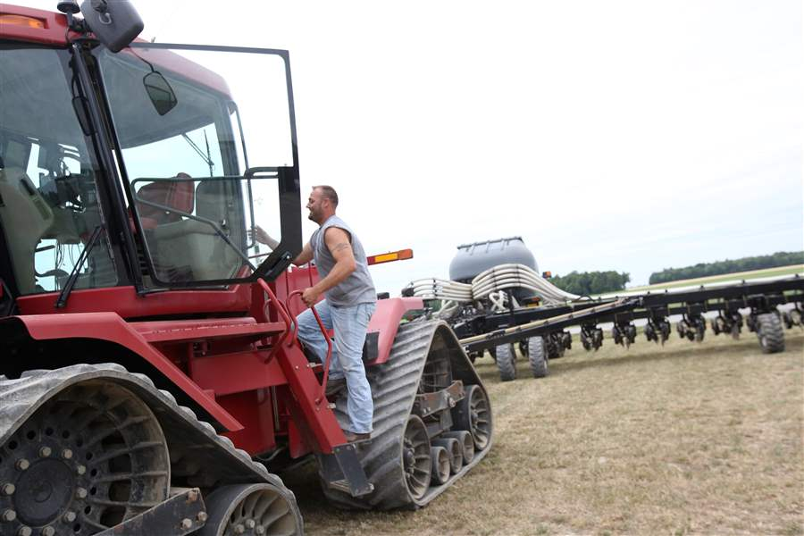 shane kellogg in 2016 climbs into the tractor pulling new equipment he and his father bill kellogg bought to help make their fertilization application and